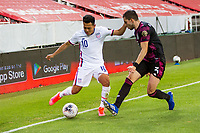 , MEXICO - : Sebastian Saucedo #10 of the United States dribbles around Manuel Mayorga #3 of Mexico during a game between  and undefined at  on ,  in , Mexico.