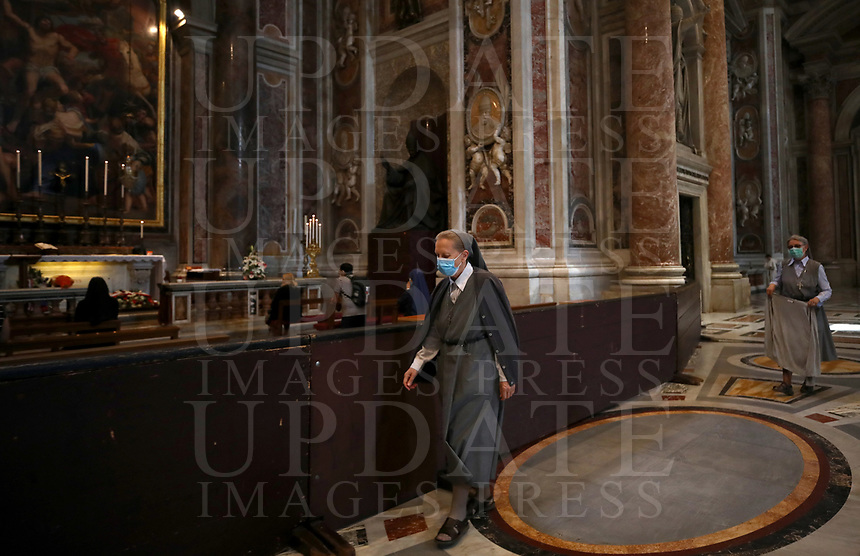 Nuns visit St. Peter's Basilica on May 18, 2020 at the Vatican in the day of its reopening. Italy is slowly lifting sanitary restrictions after a two-month coronavirus lockdown.<br /> UPDATE IMAGES PRESS/Isabella Bonotto<br /> <br /> STRICTLY ONLY FOR EDITORIAL USE