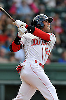 Second baseman Yoan Moncada (24) of the Greenville Drive bats in the fourth inning of a game against the Augusta GreenJackets on Thursday, July 16, 2015, at Fluor Field at the West End in Greenville, South Carolina. The Cuban-born 19-year-old Red Sox signee has been ranked the No. 1 international prospect in baseball by Baseball America. Greenville won, 11-5. (Tom Priddy/Four Seam Images)