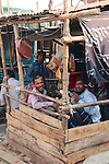 Workers take a well-earned  snack and cigarette break in a makeshift teashop in the shipyards of Old Dhaka