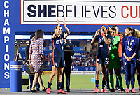 FRISCO, TX - MARCH 11: Carli Lloyd #10 of the United States applauds the fans after receiving her medal during a game between Japan and USWNT at Toyota Stadium on March 11, 2020 in Frisco, Texas.