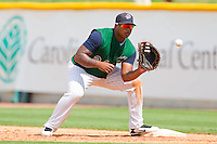 First baseman Dayan Viciedo #24 of the Charlotte Knights waits for a throw against the Syracuse Chiefs at Knights Stadium on June 19, 2011 in Fort Mill, South Carolina.  The Knights defeated the Chiefs 10-9.    (Brian Westerholt / Four Seam Images)