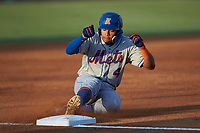 Guillermo Granadillo (4) of the Kingsport Mets slides into third base during the game against the Burlington Royals at Burlington Athletic Stadium on July 27, 2018 in Burlington, North Carolina. The Mets defeated the Royals 8-0.  (Brian Westerholt/Four Seam Images)