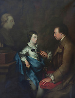 An 18th century portrait of a man and boy