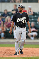 San Antonio Missions pitcher Odrisamer Despaigne (47) walks to the dugout after coaching first during a game against the Arkansas Travelers on May 25, 2014 at Dickey-Stephens Park in Little Rock, Arkansas.  Arkansas defeated San Antonio 3-1.  (Mike Janes/Four Seam Images)