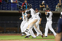 Quad Cities River Bandits Hector Roa (15) jumps on Randy Cesar (39) after a walk off base hit during a game against the Bowling Green Hot Rods on July 24, 2016 at Modern Woodmen Park in Davenport, Iowa.  Quad Cities defeated Bowling Green 6-5.  (Mike Janes/Four Seam Images)