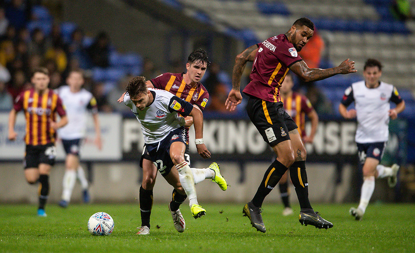 Bolton Wanderers' Dennis Politic (centre) breaks away from Bradford City's Ben Richards-Everton <br /> <br /> Photographer Andrew Kearns/CameraSport<br /> <br /> EFL Leasing.com Trophy - Northern Section - Group F - Bolton Wanderers v Bradford City -  Tuesday 3rd September 2019 - University of Bolton Stadium - Bolton<br />  <br /> World Copyright © 2018 CameraSport. All rights reserved. 43 Linden Ave. Countesthorpe. Leicester. England. LE8 5PG - Tel: +44 (0) 116 277 4147 - admin@camerasport.com - www.camerasport.com