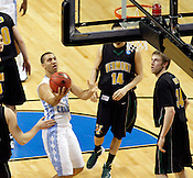 Kendall Marshall makes a layup in the first half. Marshall had 11 points overall. UNC defeated Vermont 77-58 during the 2nd round of the 2012 NCAA Basketball Championship at the Greensboro Coliseum in Greensboro, NC. Photo by Al Drago.