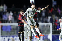 CARY, NC - DECEMBER 13: JB Fischer #8 of Georgetown University beats Keegan Hughes #5 of Stanford University to a header during a game between Stanford and Georgetown at Sahlen's Stadium at WakeMed Soccer Park on December 13, 2019 in Cary, North Carolina.