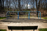 """The playground at Frick Park sits wrapped in caution tape with signs that state, """"In consideration of public health concerns from COVID-19, playground is closed until further notice"""", on Thursday April 2, 2020 in Pittsburgh, Pennsylvania. (Photo by Jared Wickerham/Pittsburgh City Paper)"""