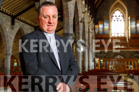 Fr Francis Nolan in an empty St John's Church on Good Friday