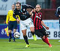 Dundee's Gary Harkins is pulled back by St Johnstone's Lee Croft.