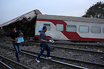 People gather at the scene of a railway accident in the city of Toukh in Egypt's central Nile Delta province of Qalyubiya on April 18, 2021. The train accident in Egypt left 97 wounded on April 18 after it derailed off its tracks heading northwards from the capital Cairo, the health ministry said, in the latest railway disaster. Eight carriages derailed off the tracks as the train headed to Mansoura, about 130 kilometres north of Cairo. Photo by Fadel Dawod