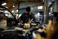 Workers on the assembly line of the Reva (G-Wiz) Electric Car Company in Bangalore, India on Wednesday, 03 January 2007.