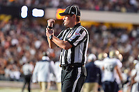 Referee Tracy Jones calls holding penalty during first half of an NCAA Football game, Saturday, September 13, 2014 in San Marcos, Tex. Navy defeated Texas State 35-21.(Mo Khursheed/TFV Media via AP Images)