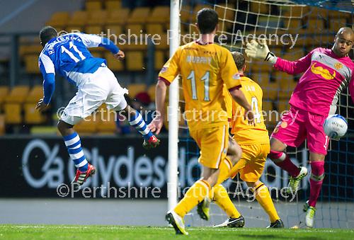 St Johnstone v Motherwell...03.11.12      SPL.Darren Randolph saves Nigel Hasselabinks header.Picture by Graeme Hart..Copyright Perthshire Picture Agency.Tel: 01738 623350  Mobile: 07990 594431