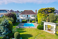 BNPS.co.uk (01202 558833)<br /> Pic: Savills/BNPS]<br /> <br /> Pictured: The swimming pool and garden.<br /> <br /> A clifftop home with breathtaking panoramic sea views is on the market for £3.25m.<br /> <br /> Sandpierre also has a private swimming pool and a viewing platform overlooking the beach with 180-degree views of the water. <br /> <br /> The six-bedroom family home is on the Bournemouth/Poole coastline in Dorset and is being sold for the first time in 25 years.<br /> <br /> The house was built in the 1930s and is in a quiet cul-de-sac in Branksome Dene Chine - midway between the town centres of Bournemouth and Poole.