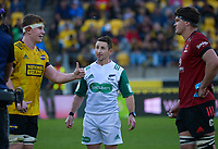 Hurricanes captain James Blackwell tosses a coin before extra time as referee Paul Williams and Crusaders captain Scott Barrett look on during the Super Rugby Aotearoa match between the Hurricanes and Crusaders at Sky Stadium in Wellington, New Zealand on Sunday, 11 April 2020. Photo: Dave Lintott / lintottphoto.co.nz
