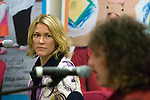 """Welsh musician Cerys Matthews (Ex Catatonia) watching ex Stereophonics drummer Stuart Cable undertake a question and answer session with members of the public inside Swansea Central Library today, to help publicise the """"Happy Days"""" campaign which demonstrates how libraries can make you happy. .The campaign is running all over Wales.."""