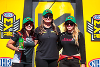 Sep 15, 2019; Mohnton, PA, USA; NHRA pro stock motorcycle rider Angelle Sampey (left) poses with pro stock driver Erica Enders (center) and top fuel driver Brittany Force during the Reading Nationals at Maple Grove Raceway. Mandatory Credit: Mark J. Rebilas-USA TODAY Sports