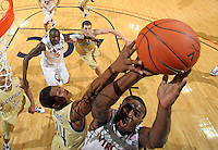 Jan. 22, 2011; Charlottesville, VA, USA; Virginia Cavaliers guard K.T. Harrell (24) is fouled by Georgia Tech Yellow Jackets guard Jason Morris (14) during the game at the John Paul Jones Arena. Virginia won 72-64. Mandatory Credit: Andrew Shurtleff-US PRESSWIRE