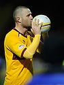 MOTHERWELL'S MICHAEL HIGDON CLAIMS THE MATCH BALL.
