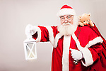An Old Fashioned Santa Claus with a lantern and gift bag