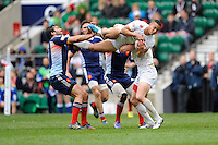 Marcus Watson of England is upended during Day Two of the iRB Marriott London Sevens at Twickenham on Sunday 11th May 2014 (Photo by Rob Munro)