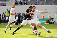 Greg Davis (14) of the Providence Friars is marked by Austin Berry (24) of the Louisville Cardinals. The Louisville Cardinals defeated the Providence Friars 3-2 in penalty kicks after playing to a 1-1 tie during the finals of the Big East Men's Soccer Championship at Red Bull Arena in Harrison, NJ, on November 14, 2010.