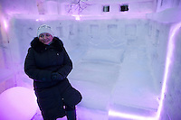 Moscow, Russia, 14/01/2012..A woman inside an ice hotel bedroom in Moroz City, or Frost City, an ice town constructed in Moscow's Sokolniki Park by a team of architects and ice sculptors. As well as ice sculptures the temporary town features a disco, hotel, fitness centre, post office and prison.