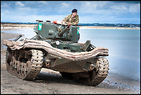 BNPS.co.uk (01202 558833)<br /> Pic: NationalTrust/MartinFranks/BNPS<br /> <br /> Pictured: Military vehicle expert Jon Pearson's last surviving duplex drive Valentine tank during an earlier visit to Studland.<br /> <br /> The medals and personal effects of an unsung hero of D-Day have emerged for sale for £6,000.<br /> <br /> Lieutenant Colonel Douglas Bain trialled the amphibious Duplex Drive tanks ahead of the Normandy landings in June 1944.<br /> <br /> He commanded three DD training schools preparing tanks for sea and river assaults, reporting personally to Field Marshal Bernard Montgomery.<br /> <br /> The dangerous trials, which tested the 'waterproofing' of the amphibious armoured vehicles, were carried out off the south coast of England.