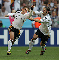 JUNE 9, 2006: Munich, Germany: German defender (16) Philipp Lahm celebrates his goal with teammate (8) Torsten Frings during the World Cup Finals in Munich, Germany.