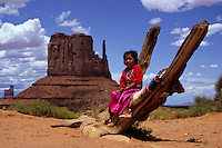 Small Indian navaho girl with reed dress in Monument Valley National Park and reservation,  Utah, USA