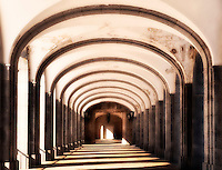 Monastery cloister walk with arches.