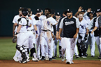 The Winston-Salem Dash celebrate their walk-off win against the Bowling Green Hot Rods at Truist Stadium on September 7, 2021 in Winston-Salem, North Carolina. (Brian Westerholt/Four Seam Images)