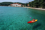 .Badidja island near Korcula. Kayak in front of the fransiscan monastery (XIV - XV ).Cruise in Croatia. Island of Dalmatia