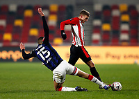 9th January 2021; Brentford Community Stadium, London, England; English FA Cup Football, Brentford FC versus Middlesbrough; Nathan Wood of Middlesbrough slides in to tackle Marcus Forss of Brentford