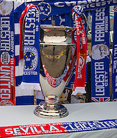 Leicester City v Sevilla Champions League scarfs sit on display beside a replica trophy before the Premier League match between Leicester City and Manchester United at the King Power Stadium, Leicester, England on 5 February 2017. Photo by PRiME Media Images / Andy Rowland.