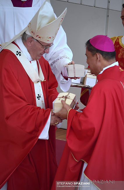 Pope Francis receives the new metropolitan archbishops during the celebratation of the mass for the imposition of the Pallium upon the new metropolitan archbishops and the solemnity of Saints Peter and Paul on June 29, 2017 in St Peter's square at the Vatican.