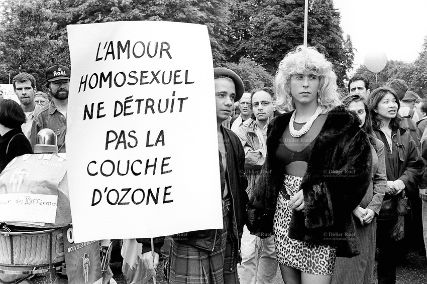 """Switzerland. Geneva. First Gay Pride parade. Two men, both homosexuals, holding a sign which says: """" Homosexual love does not destroy the ozone layer"""". © 1997 Didier Ruef"""