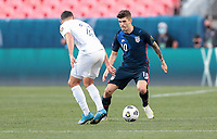 DENVER, CO - JUNE 3: Christian Pulisic #10 of the United States dribbles with the ball during a game between Honduras and USMNT at EMPOWER FIELD AT MILE HIGH on June 3, 2021 in Denver, Colorado.