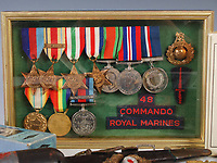BNPS.co.uk (01202 558833)<br /> Pic: LindsayBurns/BNPS<br /> <br /> Pictured: Marine Jock Mathieson's medals including the 1939-1945 Star, The Africa Star, The Italy Star, The France and Germany Star.<br /> <br /> The medals, weapons and personal effects of a hero D-Day commando have sold for over £11,000 - 22 times their estimate.<br /> <br /> Marine Jock Mathieson narrowly escaped death during the Normandy landings on June 6, 1944.<br /> <br /> A bullet pierced the fuel tank of his motorbike which he was carrying above his head while wading through the sea towards Juno Beach.