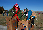 As part of National Wreaths Across America Day, volunteers Phyllis Adams and Pam Sheldon place wreaths on the graves of veterans at the Lone Mountain Cemetery, in Carson City, Nev., on Saturday, Dec. 19, 2020. The program honors veterans at more than 2100 cemeteries around the world. <br /> Photo by Cathleen Allison/Nevada Momentum Fueled by RAD