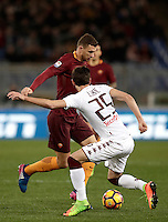 Calcio, Serie A: Roma, stadio Olimpico, 19 febbraio 2017.<br /> Roma's Edin Dzeko in action with Torino's Sasa Lukic during the Italian Serie A football match between As Roma and Torino at Rome's Olympic stadium, on February 19, 2017.<br /> UPDATE IMAGES PRESS/Isabella Bonotto