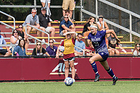 NEWTON, MA - SEPTEMBER 12: Melanie Lytle #21 of Holy Cross brings the ball forward during a game between Holy Cross and Boston College at Newton Campus Soccer Field on September 12, 2021 in Newton, Massachusetts.