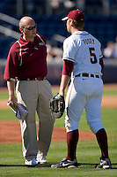 Florida State Seminoles trainer Jake Pfeil checks on Jack Posey #5 after he turned his ankle on a play at first base at Durham Bulls Athletic Park May 20, 2009 in Durham, North Carolina. (Photo by Brian Westerholt / Four Seam Images)