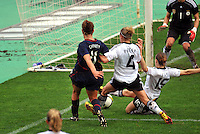 Lauren Cheney shoots amidst heavy pressure from the German defense.  The USA captured the 2010 Algarve Cup title by defeating Germany 3-2, at Estadio Algarve on March 3, 2010.