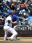 Iowa Cubs' Munenori Kawasaki beats the throw to Reno Aces' Carlos Rivero at third base in a game at Greater Nevada Field in Reno, Nev., on Tuesday, May 17, 2016. <br />Photo by Cathleen Allison