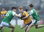 Shane Meehan of  Clare  in action against Micheal O Hanrahan and Shane Bradshaw of  Limerick during their Munster Minor football quarter final at  Cusack Park. Photograph by John Kelly.