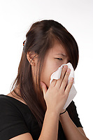 Montreal (qc) Canada -Dec 2010 - Model Released photo of a young asian adult woman sneeze in a tissue